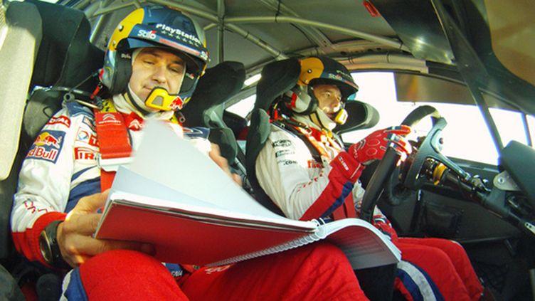 Loeb et Elena dans leur élément à bord de la Citroën C4 WRC