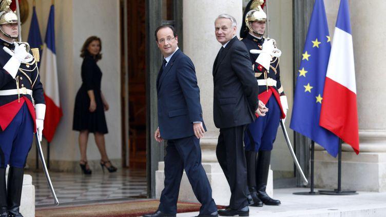 Le président François Hollande et le Premier ministre Jean-Marc Ayrault, au palais de l'Elysée, le 26 juin 2012. (CHESNOT / SIPA)