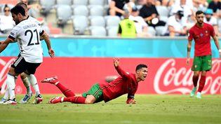 Après leur défaite contre l'Allemagne le 19 juin, Cristiano Ronaldo et le Portugal sont en position délicate dans le groupe D. (PHILIPP GUELLAND / POOL / EPA POOL)