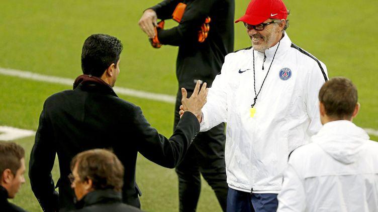 (Nasser al-Khelaifi, PDG du PSG avec Laurent Blanc, en mai dernier. ©A.Garcia/Marca/SIPA)