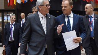 Le président de la Commission européenne, Jean-Claude Juncker, et le président du Conseil européen, le 13 juillet 2015 à Bruxelles (Belgique). (THIERRY CHARLIER / AFP)