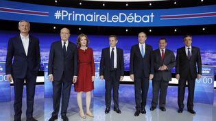Les candidats à la primaire àdroite réunis le 13 octobre sur le plateau de TF1, à la plaine Saint-Denis, pour le premier débat. (PHILIPPE WOJAZER / POOL)