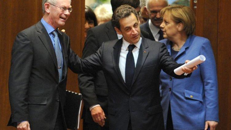Le président de l'UE Herman Van Rompuy, Nicolas Sarkozy et Angela Merkel à Bruxelles le 25 mars 2010 (AFP)