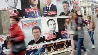 Des affiches de Jean-Luc Mélenchon, Benoît Hamon et Emmanuel Macron, le 10 avril 2017 à Paris. (DENIS ALLARD / REA)