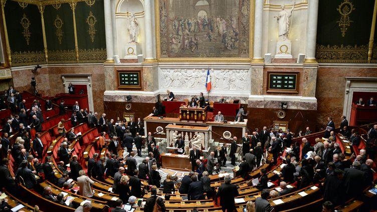 Les députés quittent l'hémicycle après le vote du budget 2014 de la Sécurité sociale, le 29 octobre 2013 à Paris. (PIERRE ANDRIEU / AFP)