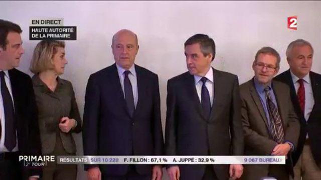 Poignée de main entre Alain Juppé et François Fillon