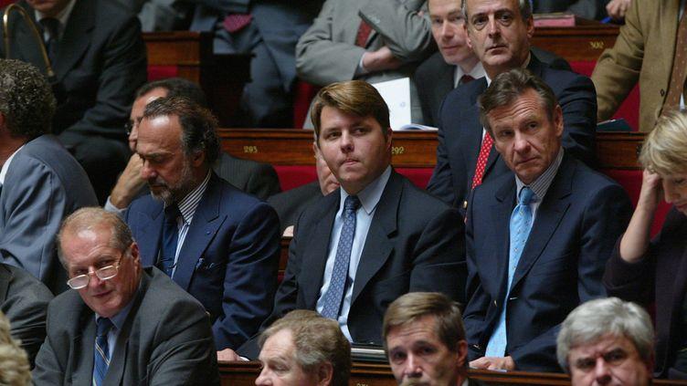 (De gauche à droite) Olivier Dassault, Edouard Courtial et Jean Francois Mancel, le 14 octobre 2003, lors de la seance des questions au gouvernement à l'Assemblee nationale. (Benoit TESSIER/MAXPPP)