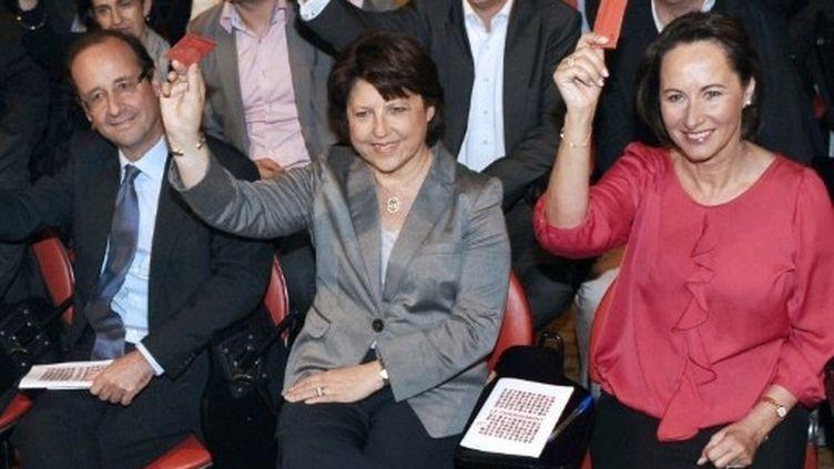 Trois des six candidats à la primaire PS: François Hollande, Martine Aubry et Ségolène Royal. (AFP - Miguel Medina)