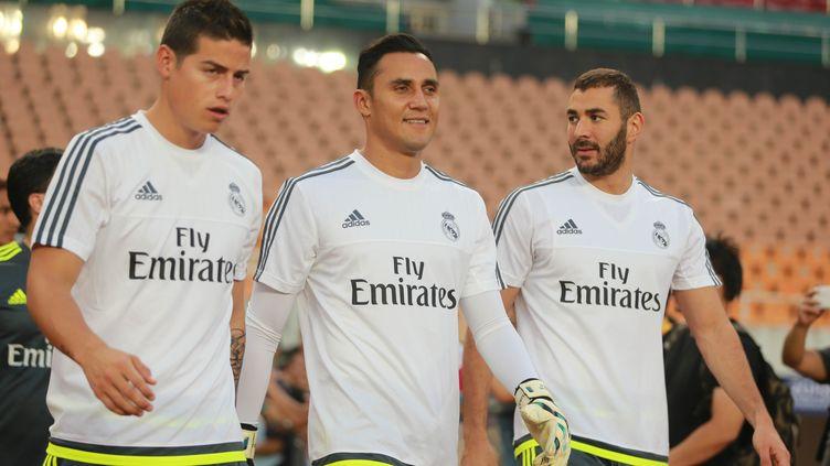 James Rodriguez et Karim Benzema autour de Keylor Navas avec le Real Madrid. (PI JIUSHI / IMAGINECHINA)