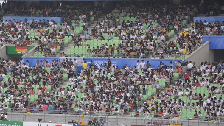 La foule prend place dans les tribunes du Stadium de Daegu