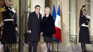 François Fillon et Penelope Fillon, le 26 janvier 2012, à l'Elysée. (LIONEL BONAVENTURE / AFP)