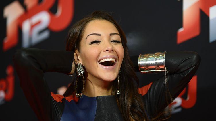 La star de la téléréalité Nabilla Benattia au siège du groupe NRJ, le 21 octobre 2013. (ERIC FEFERBERG / AFP)