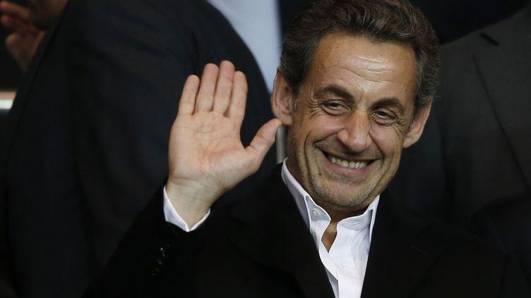 L'ancien président Nicolas Sarkozy au Parc des Princes, à Paris, le 2 avril 2014. (GONZALO FUENTES / REUTERS)