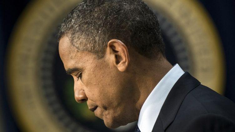 """Le président américain, Barack Obama, lors de son intervention face à la presse après la validation par le Sénat de l'accord sur le """"mur budgétaire"""", le 31 décembre 2012 à Washington (Etats-Unis). (BRENDAN SMIALOWSKI / AFP)"""