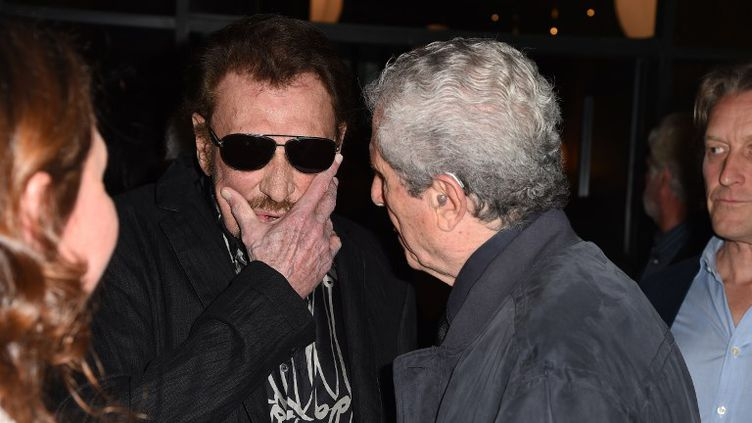 Johnny Hallyday et Claude Lelouch, le 24 avril 2017. (ROBYN BECK / AFP)