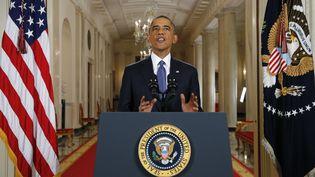 Le président américain, Barack Obama, annonce son plan sur l'immigration à la Maison blanche, à Washington (Etats-Unis), le 20 novembre 2014. (JIM BOURG / AFP)