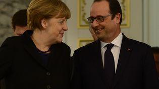 Angela Merkel et François Hollande, à Minsk (Biélorussie), jeudi 12 février 2015. (SEFA KARACAN / ANADOLU AGENCY / AFP)