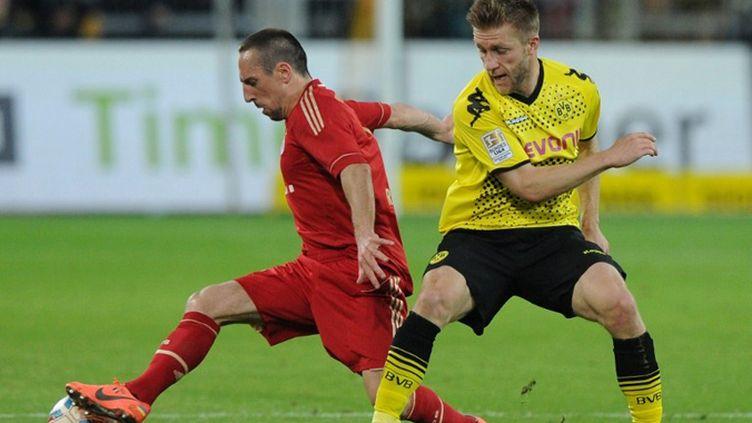 Franck Ribéry (Bayern Munich) en duel avec Jakub Blaszczykowski (Dortmund)