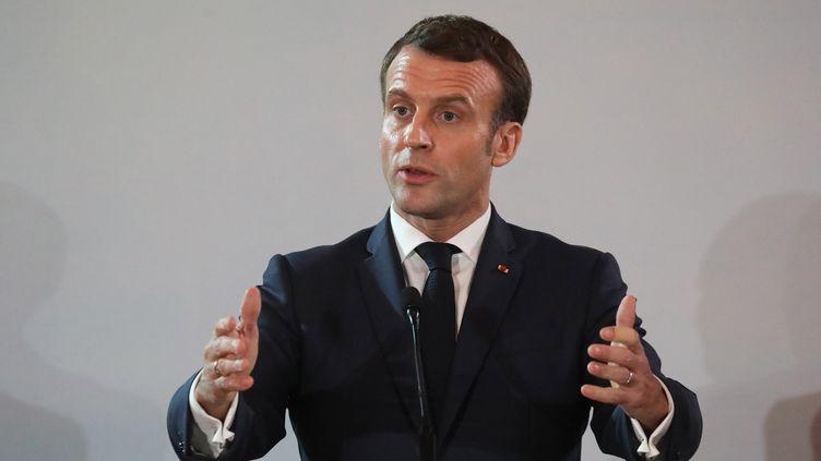 Emmanuel Macron lors d'une conférence de presse à Abidjan (Côte d'Ivoire), le 21 décembre 2019. (LUDOVIC MARIN / AFP)