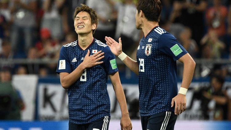 Le japonais Genki Haraguchi célèbre l'ouverture du score lors du 8e de finale contre la Belgique, le 2 juillet 2018, àRostov, en Russie. (FILIPPO MONTEFORTE / AFP)