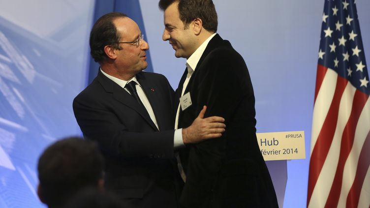 François Hollande étreint Carlos Diaz, leader du mouvement des Pigeons, le 12 février 2014, à San Francisco (Californie). (ROBERT GALBRAITH / REUTERS)