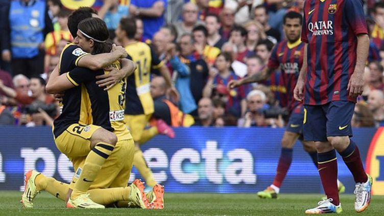 La joie des joueurs de l'Atletico après l'égalisation face au Barça (LLUIS GENE / AFP)