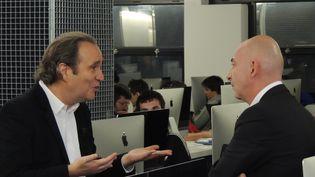 Xavier Niel, vice-président du groupe Iliad et François Lenglet. Paris novembre 2014. ( FRANCE 2 / FRANCE TV INFO )
