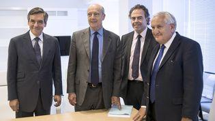 François Fillon, Alain Juppé,Luc Chatel et Jean-Pierre Raffarin (de G à D), direction provisoire de l'UMP, à Paris le 17 juin 2014. (FRED DUFOUR / AFP)