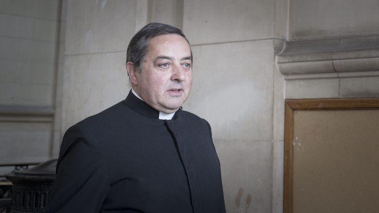 L'abbé Xavier Beauvais au palais de justice de Paris, le 25 mars 2015. (  MAXPPP)