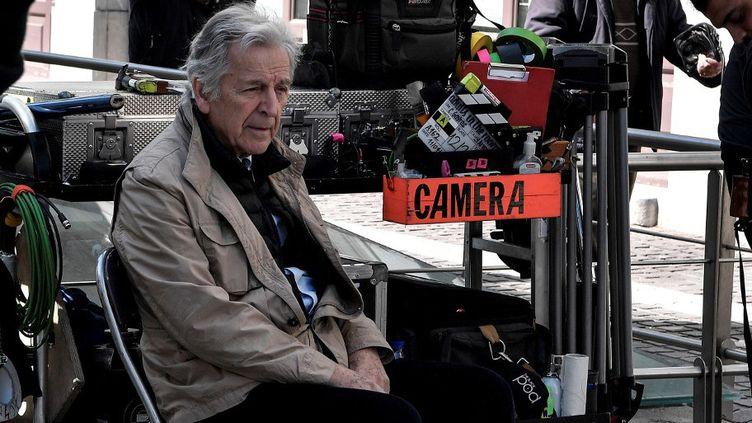 Le réalisateur franco-grec Costa Gavras en tournage à Athènes en avril 2019  (Louisa GOULIAMAKI / AFP)