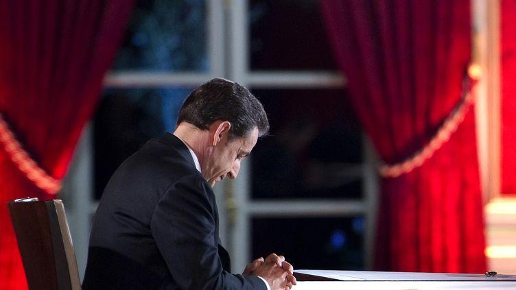 L'ancien président Nicolas Sarkozy, le 29 janvier 2012, au Palais de l'Elysée (Paris). (LIONEL BONAVENTURE / AFP)
