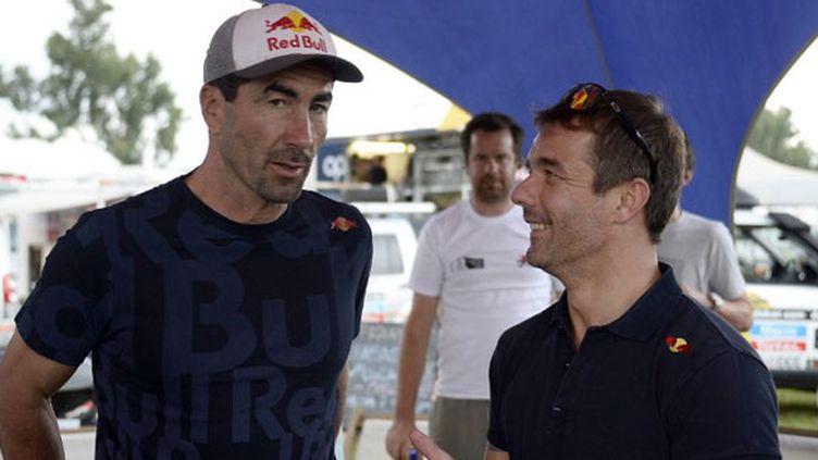 Le nonuple champion du monde des rallyes Sébastien Loeb avec Luc Alphand
