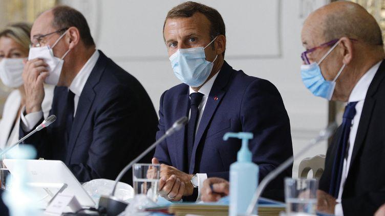 Jean Castex et Emmanuel Macron, en août 2020. (KAMIL ZIHNIOGLU / POOL)