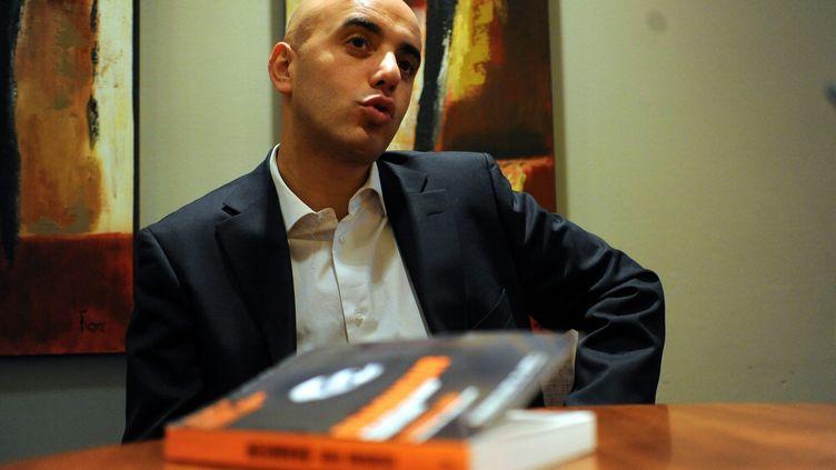 Le braqueur Redoine Faïd, photographié en 2011 lors de la présentation de son livre. (MAXPPP)