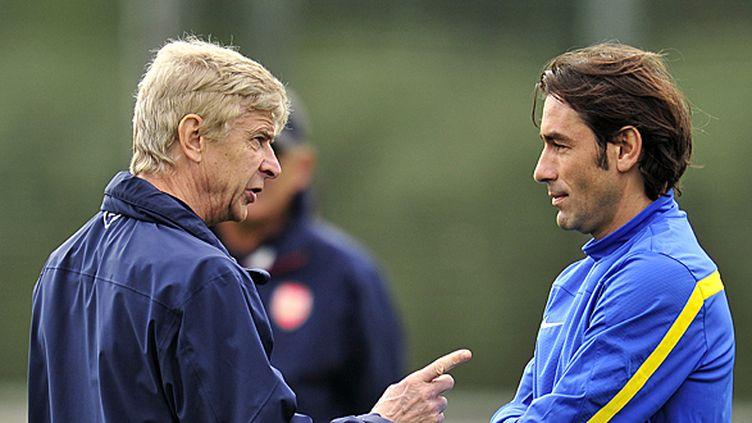Robert Pirès espère qu'Arsène Wenger va prolonger son contrat à Arsenal.  (GLYN KIRK / AFP)