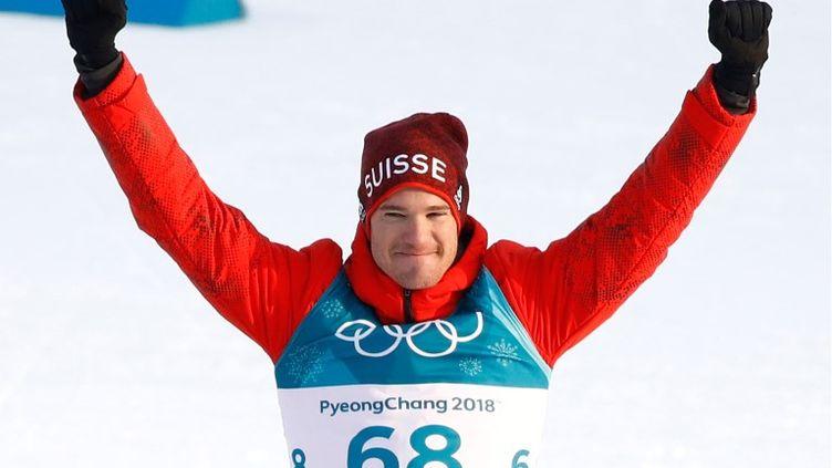 Avec quatre titres olympiques en poche, le Suisse Dario Cologna est entré un peu plus dans la légende. (ODD ANDERSEN / AFP)