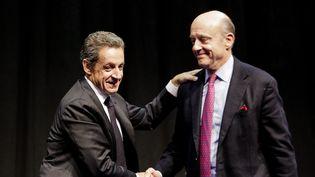 Nicolas Sarkozy et Alain Juppé en meeting à Limoges (Haute-Vienne), le 14 octobre 2015. (MAXPPP)