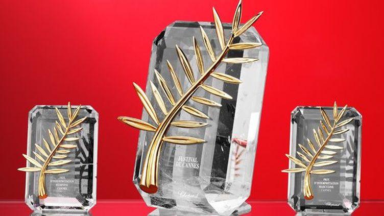 Les trois modèles de Palmes cannoises : la palme d'or, et les Prix d'interprétation féminine et masculine  (CHOPARD/AFP)