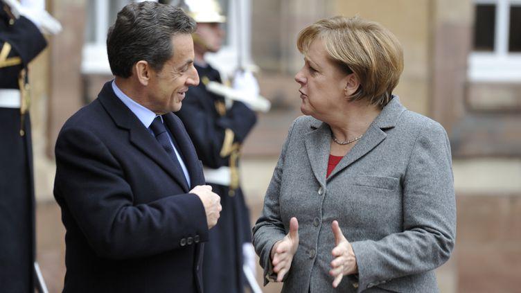 Nicolas Sarkozy et Angela Merkel à Strasbourg (Bas-Rhin), pour le mini-sommet européen du24 novembre 2011. (ERIC FEFERBERG / AFP)