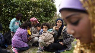 Des Syriens qui ont trouvé refuge depuis un an à Montevideo (Uruguay), le 7 septembre 2015. (MATILDE CAMPODONICO / AP / SIPA)