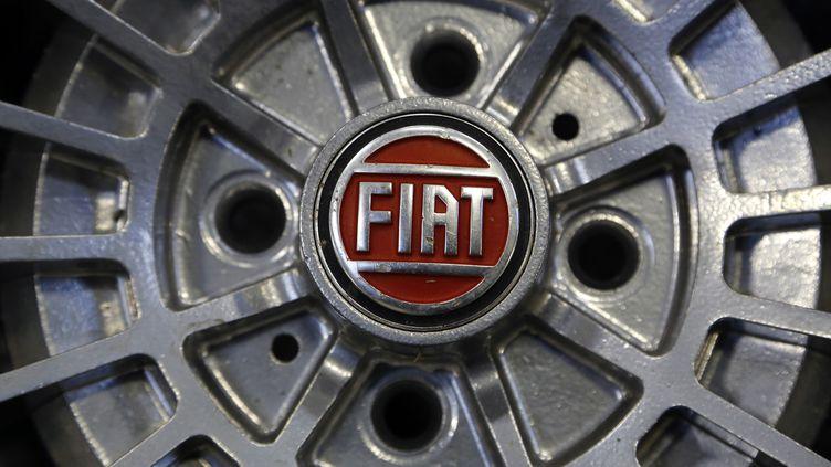 Fiat a mis fin à un conflit avec son coactionnaire pour prendre le contrôle total de Chrysler, le 1er janvier 2014. (STEFANO RELLANDINI / REUTERS)