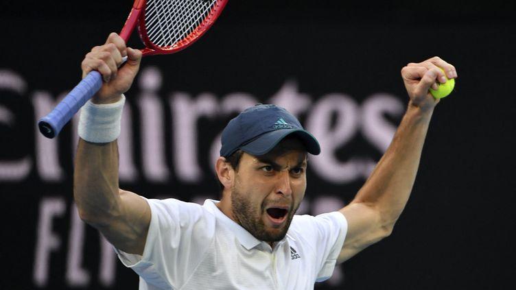 Aslan Karatsev lors de sa victoire face Diego Schwartzman. (PAUL CROCK / AFP)