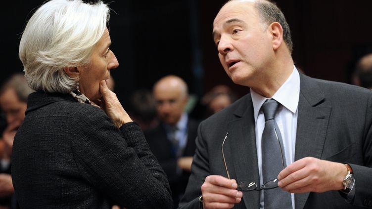 Christine Lagarde, directrice du Fonds monétaire international, et Pierre Moscovici, ministre français de l'Economie et des finances, au cours d'une réunion de la zone euro, à Bruxelles, en mars 2013. (JOHN THYS / AFP)