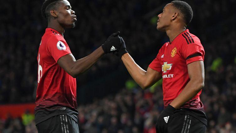 Anthony Martial et Paul Pogba portent Manchester United cette saison (PAUL ELLIS / AFP)