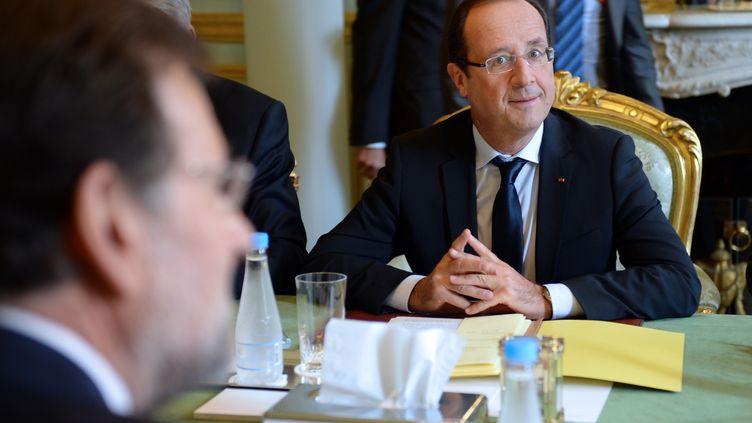François Hollande etle chef du gouvernement espagnol,Mariano Rajoy, le 10 octobre 2012 à l'Elysée, à Paris. (FRED DUFOUR / AFP)