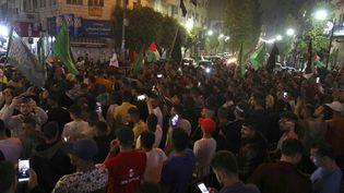 Des Palestiniens à Ramallah, le 21 mai 2021. (ABBAS MOMANI / AFP)