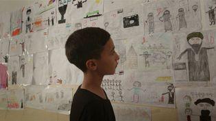 Comment dire l'indicible ? Ces enfants orphelins victimes des exactions de Daech ont pu dessiner l'horreur et les ténèbres et décrire ce qui se passaitdans cesdessins. (GIANFRANCO ROSI)
