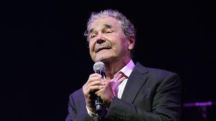 Le chanteur Pierre Perret sur la scène de l'Olympia, à Paris, le 9 juillet 2014. (BERTRAND GUAY / AFP)