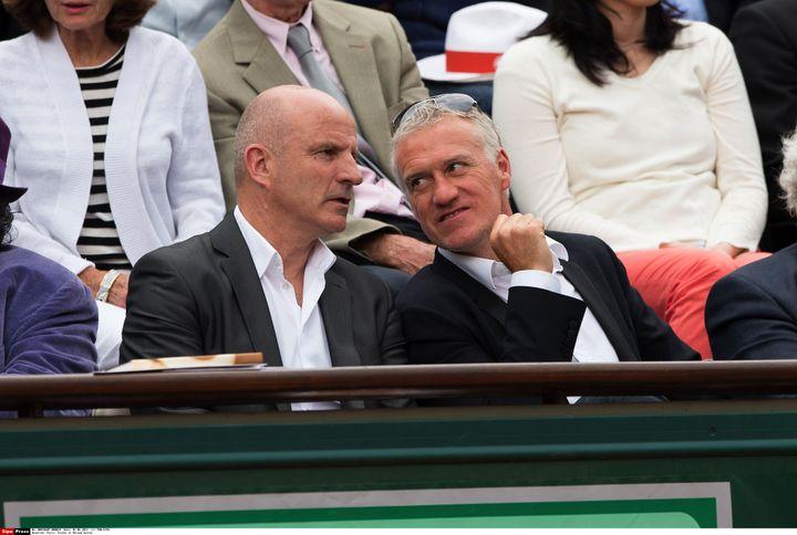 Guy Stéphan et Didier Deschamps, complices même dans les tribunes de Roland-Garros, le 1er juin 2013. (PDN/SIPA)