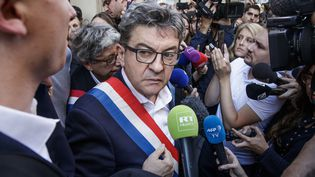 Jean-Luc Mélenchon devant le siège de La France insoumise, visé par une perquisition, le 16 octobre 2018, à Paris. (MAXPPP)